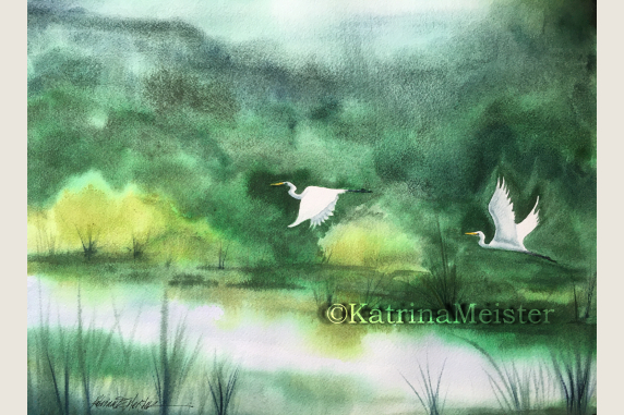 watercolor of lush green landscape with two white egrets flying over water