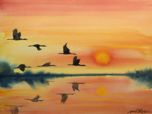 watercolor of warm sunset colors with flying cranes reflected on water