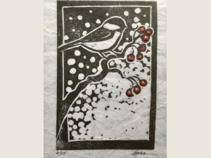 block print of chickadee with snow and red berries on artistically curvy branch