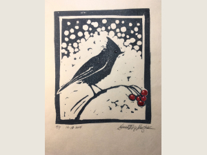 block print of songbird  on berry branch with snow